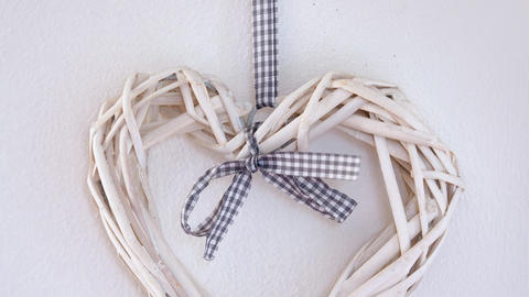 Wicker hearts with ribbon on a wall Footage