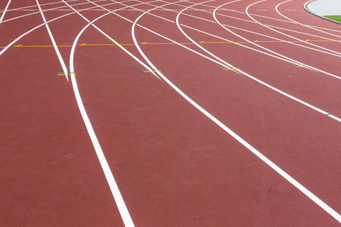 Red sport track for running on stadium with white lines. Running healthy Photo