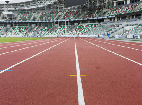 Red sport track for running on stadium with tribune. Running healthy lifestyle フォト