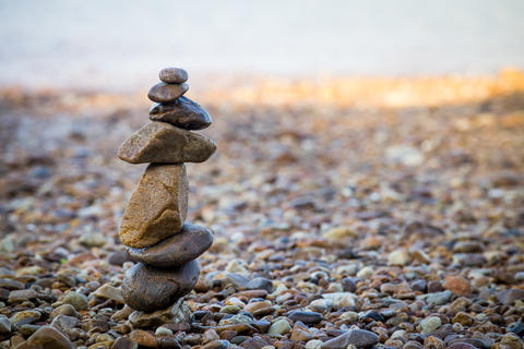 Close up stack of zen stones on the beach Photo