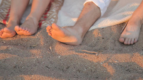 Legs of lovers in the sand on the beach ビデオ