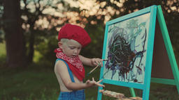 Child Boy Drawing Picture Outdoors in Summer Footage