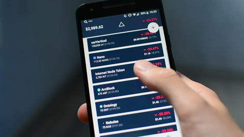 Person is holding mobile phone checking, cryptocurrency balance in portfolio app Footage