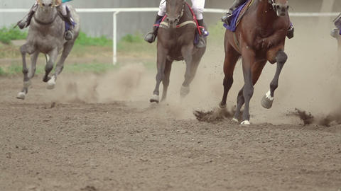 Horse Riders at the Turn of the Racetrack. Slow Motion Footage