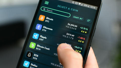 Checking Bitcoin cryptocurrency portfolio list on Ethos universal mobile wallet Footage