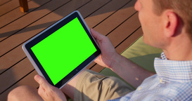 Man Uses Blank Green Screen Tablet PC Outside Footage