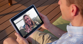 Man Video Chats with Woman on Tablet PC Outside Footage
