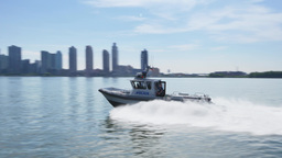 Police Boat Speeds Past on East River Footage