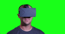 Man in VR Helmet Spinning Green Screen Footage