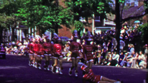 1952: Marching band chorus line parade woman falls after high kick Footage