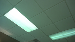An office fluorescent light turns on then off Footage