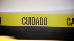 Closeup Caution Cuidado Sign in Spanish Footage