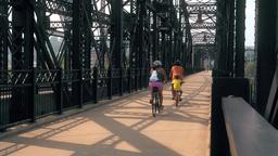 Hot Metal Street Bridge Bicyclists stock footage