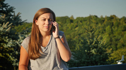 Teenaged Girl Talks on Cellphone Outside Footage
