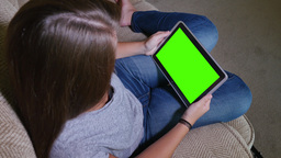 Teen Girl Uses Green Screen Tablet PC in Home Footage