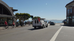 Bicyclists Ride into Downtown Sausalito California Footage