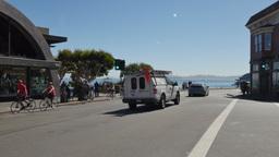 Bicyclists Ride into Downtown Sausalito California Footage