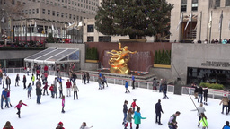 Tourists Skate at the Rockefeller Center Ice Rink Footage