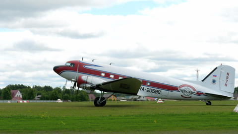 Douglas DC-3 taxiing on airfield Live Action