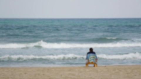 Ocean beach person sitting relax Footage