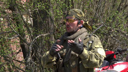 Commander of the gaming team in military uniform gives an installation on game Footage