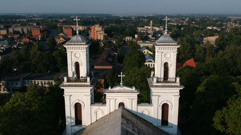 Drone fly down near white old christianity church Footage