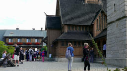 Tourists waiting in a queue to see Vang stave church in Karpacz town, Poland Footage