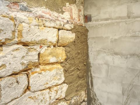 Sandstone block wall on ancient building, traditional architecture フォト