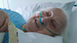 Old, sick woman in hospital bed Footage