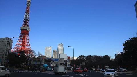 Intersection behind Tokyo tower wide shot left side ビデオ