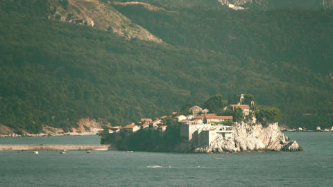 Iconic telephoto shot of famous island village Sveti Stefan in Montenegro Footage