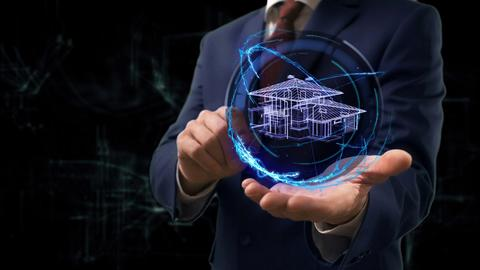 Businessman shows concept hologram 3d house on his hand Fotografía