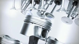 Engine pistons on a crankshaft, isolated on white background, with clipping path Footage