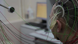A male patient undergoes medical research using new medical technologies. Cyber Footage