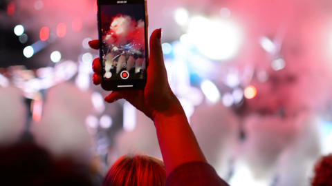 Taking a photo with mobile phone iPhone during rock band music performance Footage