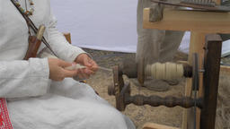Woman is spinning wool on a spinning wheel 2 Live Action