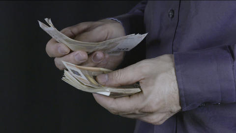 Businessman counts money in hands. Dollars Footage