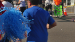 Excited Spectator Encourages Participants in LA Marathon Footage