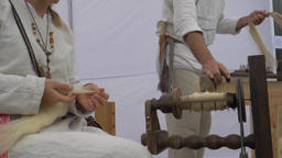 Spinning wheel. Woman is spinning wool. Slow motion Live Action