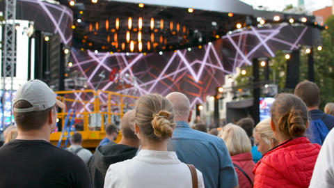 Diverse people crowd at live rock concert music stage performance festival on Footage