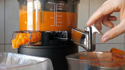 Process of extracting fresh juice from carrot and pineapple Live Action