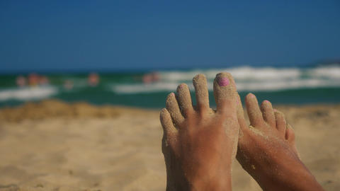 Lazy feet on the beach with sand on toes Stock Video Footage