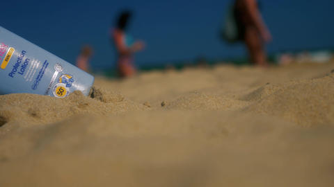 Sun protection lotion on the beach Stock Video Footage