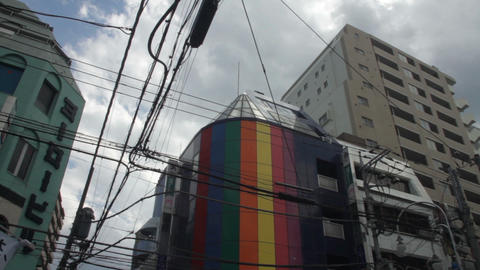 Electric line crossing with building wide shot deep focus at Hachiouji ビデオ