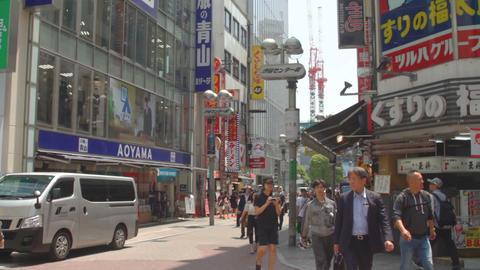 Center Street at Shibuya daytime middle shot standard focus ビデオ