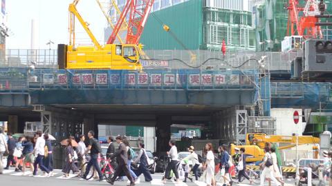 People come and go at Miyamazuzaka street in Shibuya middle shot ビデオ