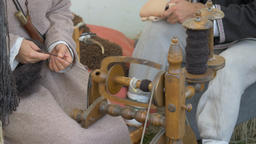 Woman is spinning wool on a spinning wheel 1 Live Action