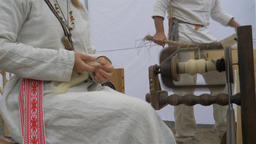 Woman is spinning wool on a spinning wheel 6 Live Action