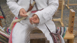 Woman is spinning wool on a spinning wheel 4 Live Action