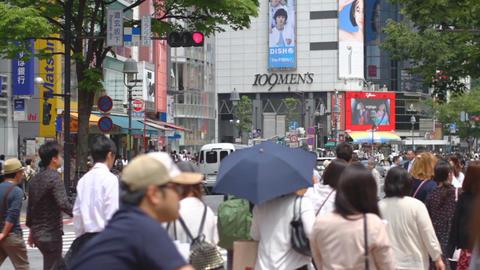 Shibuya crossing at Dougen Street middle shot shallow focus ビデオ